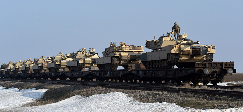 Daniel Mihailescu/AFP. US Army personnel offload military equipment at the Mihail Kogalniceanu Air Base near Constanta in Romania on February 14, 2017